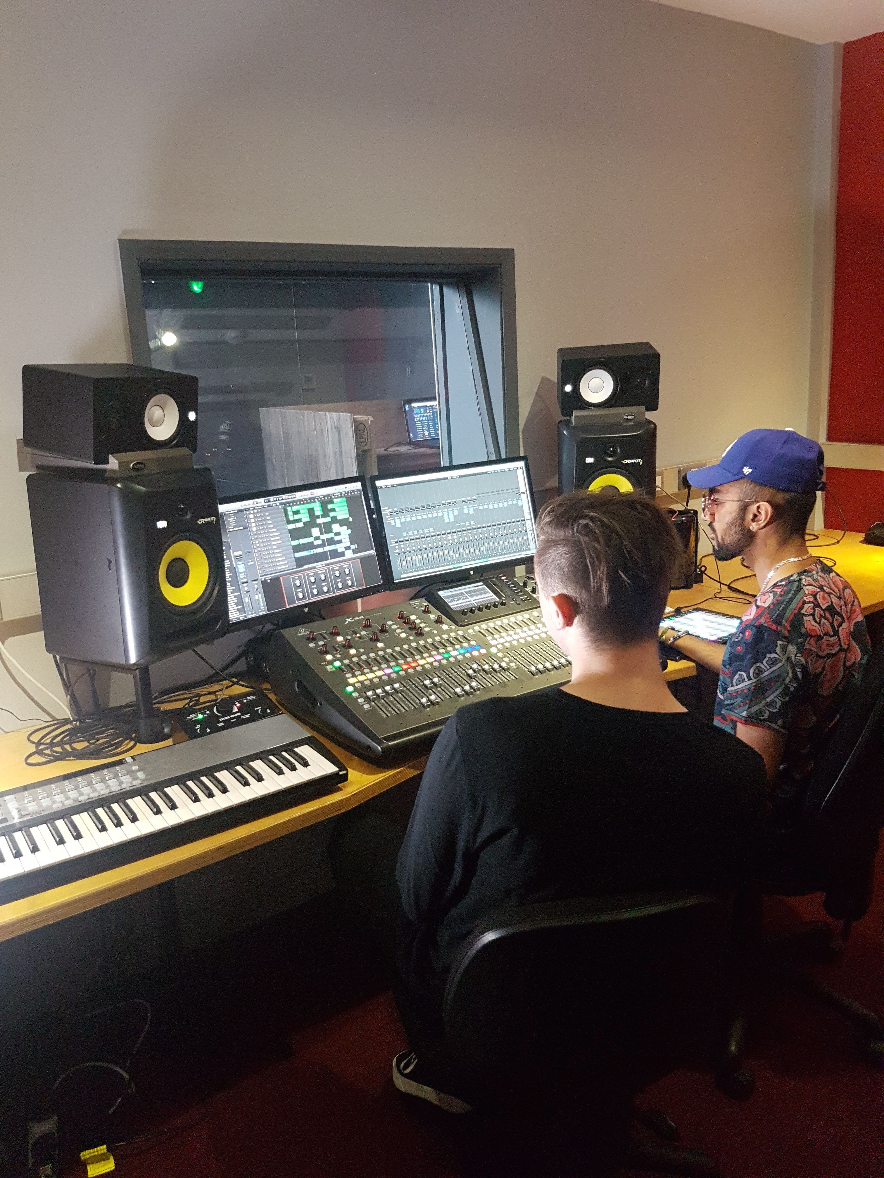 Image of two young men in a recording studio