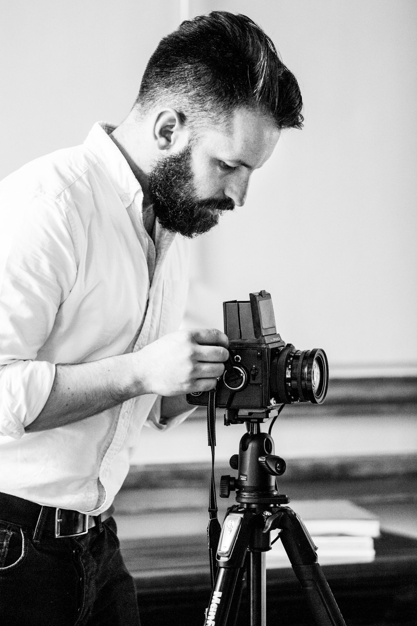 Photograph of Scott Choucino using a camera