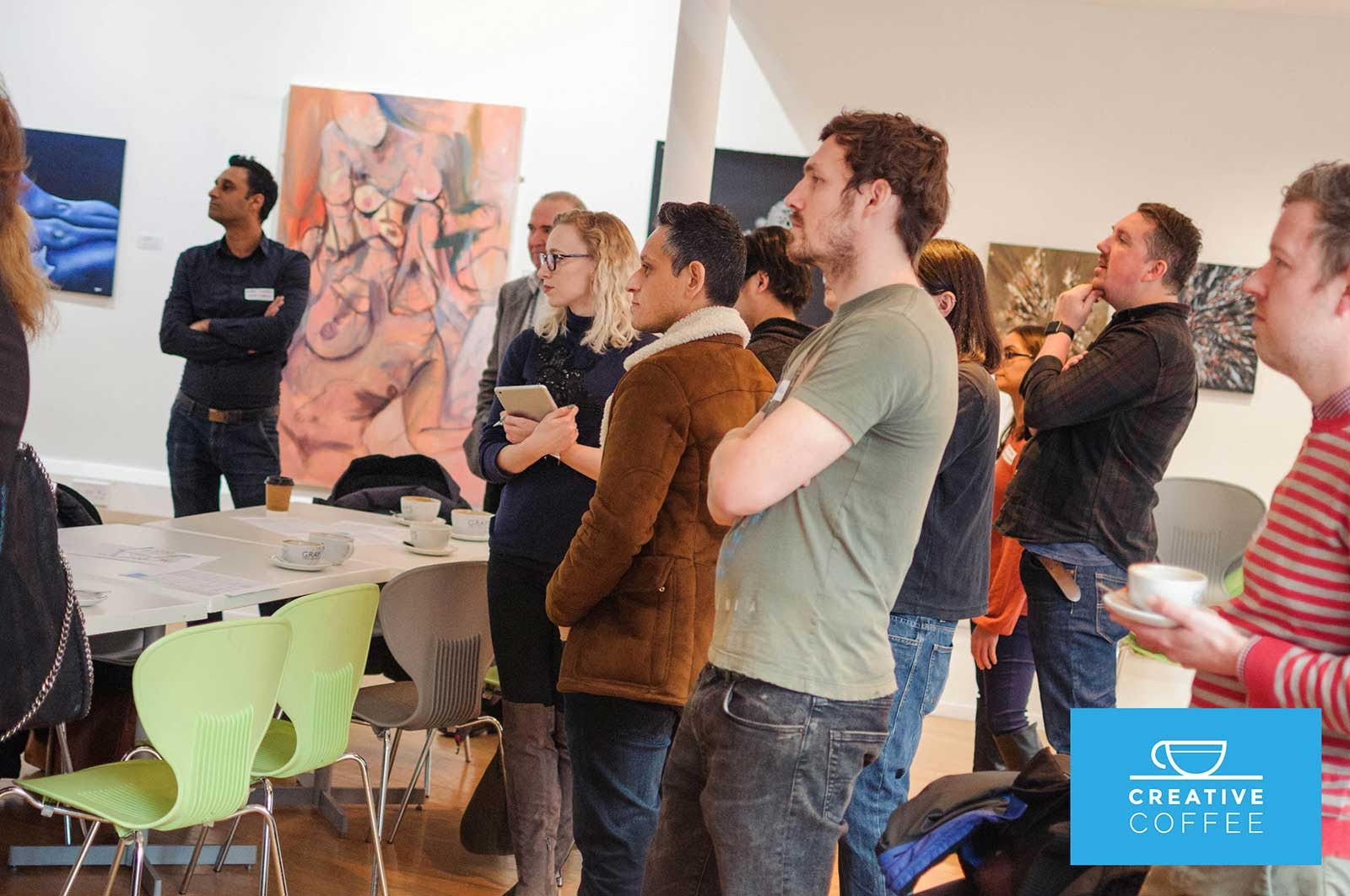 Photograph of people drinking coffee at a networking event